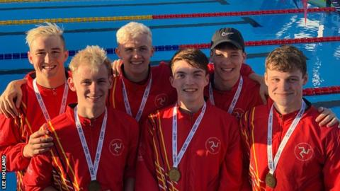 The Isle of Man men swimmers with their gold medals