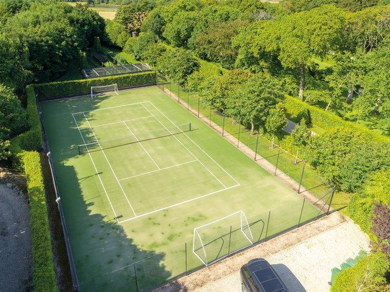 The property even boasts its own tennis court