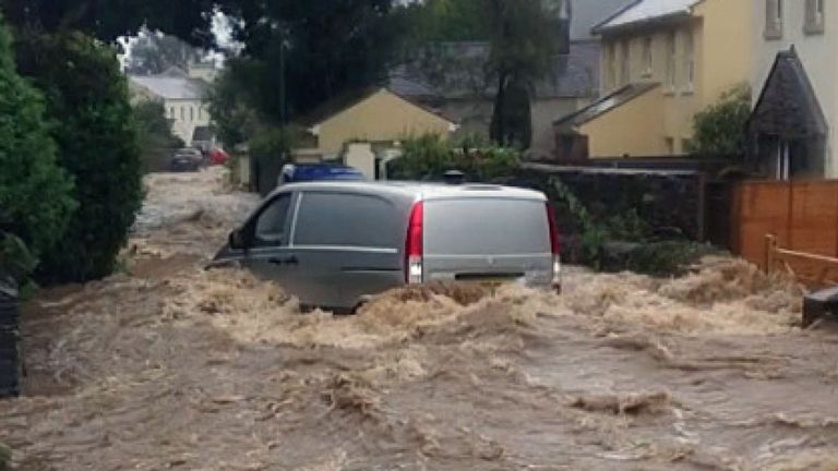A car in a flooded street in Laxey, Isle of Man