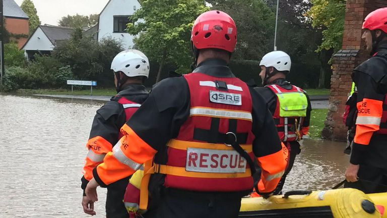 Rescue workers were seen walking through a residential area in Leicestershire earlier