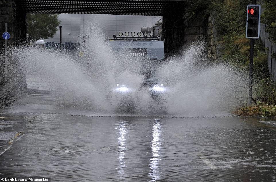 Motorists make their way through flooded roads after heavy rainfall overnightin Gateshead, Tyne and Wear