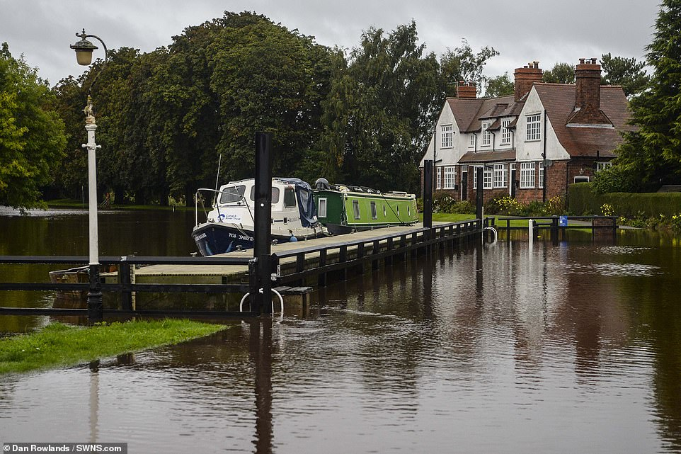 A heavily flooded Naburn Lock along the River Ouse outside York this morning as heavy rain continues to batter the region