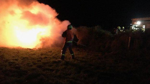 A car on fire during Isle of Man Pokerstars Rally